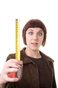 Young woman holding tape measure